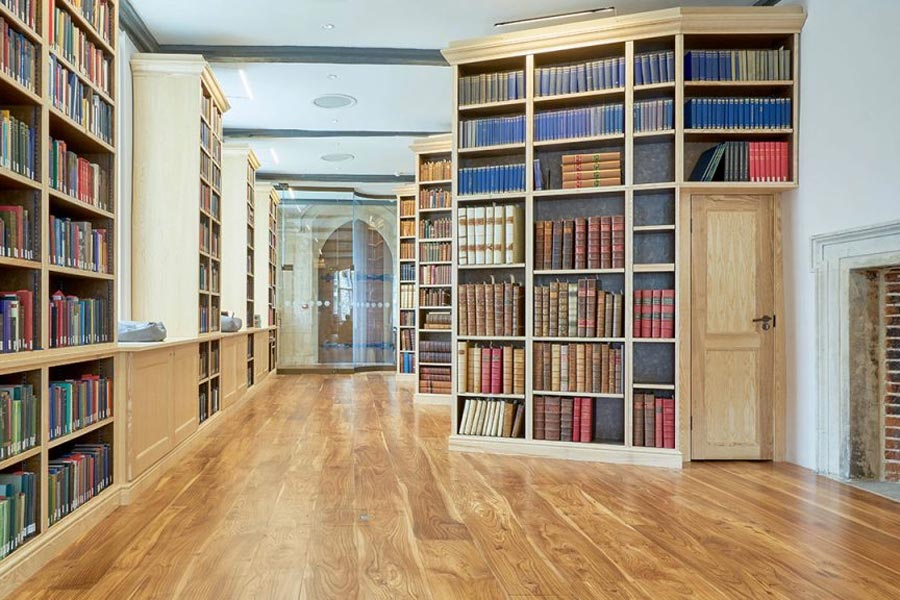 elm floor in rochester cathedral library with book shelves