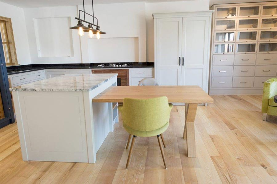 solid ash flooring grey kitchen cabinetry and lime furniture