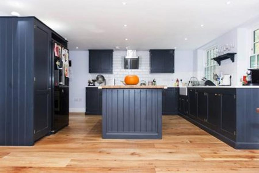 solid elm kitchen floor with dark blue painted cabinetry
