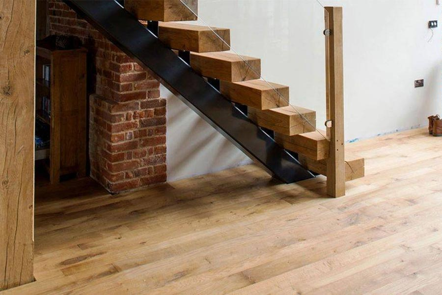 solid oak stair risers with glass panel and solid oak flooring