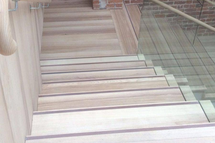 white oiled ash staircase with ash handrail and glass side